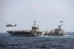 EAST CHINA SEA (Oct. 14, 2013) The Nimitz-class aircraft carrier USS George Washington (CVN 73) conducts a replenishment-at-sea with the Henry J. Kaiser-class underway replenishment oiler USNS Yukon (T-AO-202). #USSGW