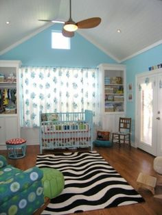 This room creates a magical underwater oasis full of color and texture. I love the pop of color that the zebra rug adds.