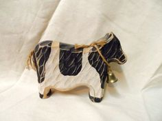 Thanks for visiting us at Orphan Treasures ~ We have this fun vintage carved cow figurine for your consideration. This primitive cow is cute as can be and loaded with charm. It measures approx. 1.5 wide x 6 tall x 7.5 long. This item is being sold exactly as it came to us, so it may need a light cleaning upon arrival. If you have any questions about the item or would like to see additional pictures please feel free to contact us. please be sure to look at the pictures to determine…