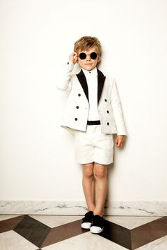 A double breasted jacket comes in a color-blocked version and is paired with cool, coordinating shorts for a dapper and darling boyswear summer party look.