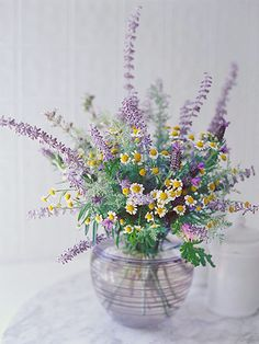 Fragrant Herbal Delight - Combine English and Spanish lavender with daisylike chamomile and scented geranium for an aromatic floral feast that looks and smells stunning. These flowers grow well together and love hot, sunny gardens