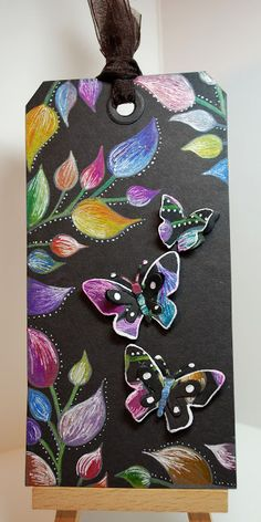 5/10/2012; Eileen at 'Eileen's Crafty Zone' blog; Dylusions Stamps and a Quickutz Butterfly make a Black Magic Tag; image stamped with white pigment ink; coloured pencils finish this great tag!  Wonderful technique for cards too.