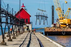 """Special offer this coming weekend - """"Buy One, Get One Half Off"""" of Bob Walma's Restoration project of Grand Haven's CatWalk.  #savethecatwalk #visitgrandhaven #lakemichigan #corpofengineers #cranes #lighthouses #red #yellow"""