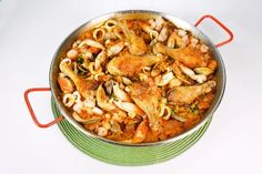 1986 Paella by Mario Batali - Chicken, seafood, and chorizo are brought together in this classic from Marios past! .