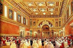 The Ballroom is the largest room at Buckingham Palace. It was added by Queen Victoria and is used for ceremonies such as investitures and state banquets. This picture dates from 1856. The polychrome colour scheme has been replaced by mainly white decoration with gold details and red upholstery.
