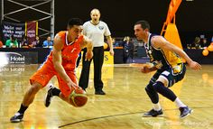 Southland Sharks' Reuben Te Rangi about to scoot past an Otago Nugget player . Stadium Southland, June Southland Sharks v Otago Nuggets. Shark S, Basketball Court, June, Sports, Hs Sports, Sport, Exercise