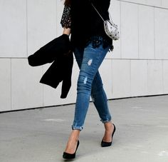 black lace top, jeans, metallic bag and heels