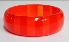 Vintage Lucite Tone On Tone Striped Bangle Bracelet, shades of red