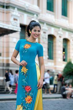 Vietnamese dress (ao dai)  I like this one. (turquoise or purple)