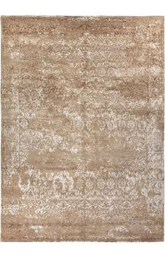 This collection of rugs has a distressed look but still brings a touch of glamour to any home!  Jaipur Rugs Jenny Jones-Global CG04 Beige Rug