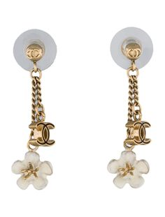 From the Spring 2010 Collection. Gold-tone Chanel interlocking CC drop earrings with black and white enamel, camellia charm and post closures. Includes box and pouch.