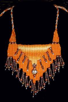 Creamsicle Cascade - 2014 - Available - Adjustable length, cascade pattern.   Woven by Terri Scache Harris, theravenscache.shutterfly.com   Hand woven, handwoven, weaving, weave, needleweaving, pin weaving, woven necklace, fashion necklace, wearable art, fiber art.