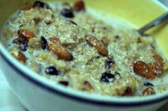 1 cup cooked oatmeal  1 tsp. orange extract  Zest of 1 orange  1/2 tsp. cinnamon  1/4 cup cranberries  1/4 cup almonds  1/2 cup non fat milk