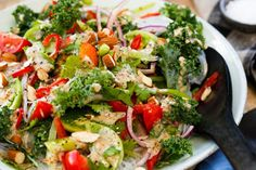 Tomato, kale and vermicelli salad with almond and honey dressing