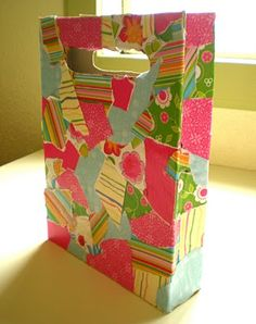 """Here's what I'm gonna do:  take my cereal boxes and my scraps of Christmas paper to make gift """"bags"""" for next year.  Instead of cutting handles, we'll punch holes and add ribbons/strings."""