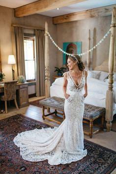 This daring sheer bodice lace wedding dress is stunning!