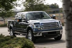 2013-Ford-F-150-SuperCrew-EcoBoost-King-Ranch-front-view-in-motion