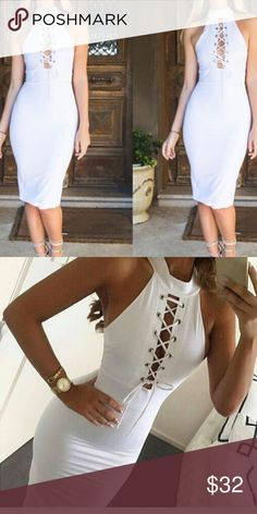 White lace up dress A lovely midi dress. Form fitting. True to size. Polyester, spandex. It has a turtle neck sleeveless fit. A plunging cutout v neck that is a strap lace up. Super sleek and comfortable, boutique item Dresses Midi