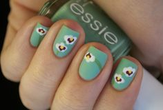 Orchid inspired nail art!    -    Turquoise & Caicos - Essie (base color), Green - Color Madric (stems), French White Creme - Wet n' Wild (white petals), Plum Truffle - CND (purple petals) and Lightening - Sally Hansen Insta-Dri (yellow centers).