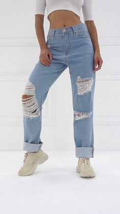 High-waisted mom jeans featuring a distressed knee slit, five-pocket construction, and zip fly with a button closure. Boyfriend Jeans, Slim Mom Jeans, High Waist Outfit, Jeans Vintage, Cute Ripped Jeans, Faded Jeans, Cropped Jeans, Looks Jeans, Mom Jeans Outfit