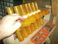 1000 images about uses for empty plastic pill bottles on for Pill bottle storage rack