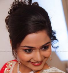 side swept hairstyle with bun for Indian weddings