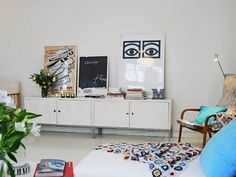 There never seems to be enough surface space for serving platters and dishes during the holidays; we like this sideboard in a Swedish home, made from a pair of Ikea PS Cabinet, creating an eight-foot long instant credenza. Living Room Scandinavian, Scandinavian Wallpaper, Scandinavian Interior Design, Scandinavian Style, Scandinavian Apartment, Armoire Ikea Ps, Ikea Ps Cabinet, Ikea Cabinets, Base Cabinets