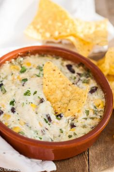 Smoked Cheddar Southwestern Dip...black beans and corn combined with cheddar cheese and spring onions baked until melted