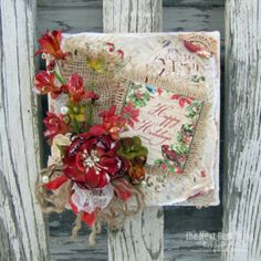 This Christmas CANVAS from Lynne Forsythe makes a wonderful holiday gift!  It has been ALTERED with Burlap trims, Botanica Blooms and Floral Ephemera from Petaloo along with Christmas paper from Graphic 45!