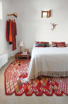 rug designer Nani Marquina and photographer Albert Font's vacation home -- master bedroom with Losanges rug