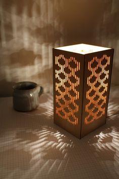 Fan lamp, laser cut birch lighting by Hannah Christie.