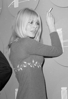 Brigitte Bardot during a press conference on her arrival in New York City to promote Viva Maria, 1965.