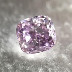 This is a beautiful .29 carat, GIA certified Natural Fancy Intense Purple Pink, Cushion Brilliant shape and cut Diamond with an SI2 clarity. A beautiful Natural Fancy Intense Purple Pink that will look stunning when set. This loose diamond has an amazing color. Let one of our Diamond Specialists help you.