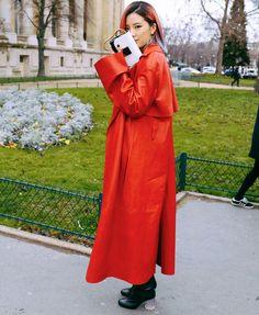 Irene Kim in anAcne Studios coat with a Jimmy Choo bag