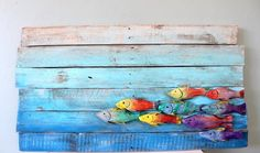 Colorful Hand Carved Fish of the Sea Wall Hanging Decor Built at the beach, ocean inspired! This unique piece is the only of its kind, the backing wood is reclaimed pine and the fish are hand carved out of old European oak wine barrel staves.  All wood used at Eco Art Wood Design is reclaimed and re-purposed. We strive to build beauty out of the discarded from old fences and decking, furniture and pallets to fallen trees in the forest. Our purpose is to give new life to old wood.  If you…