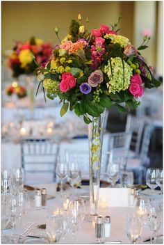 Tall centerpieces- I like the flowers in the vase.