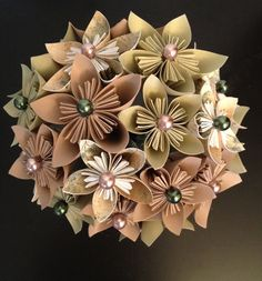 These bouquets are just amazing! Peach and Neutral Paper Flower Bouquet by LovelyPetalsBoutique. $58.00 USD, via Etsy.