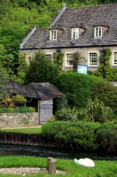 "Bibury, England | This old village is known for both its honey-colored stone cottages with steeply pitched roofs as well as for being the filming location for movies like Bridget Jones' Diary. It's been called ""the most beautiful village in England."""