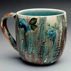 Luba Sharapan - an intriguing blend of traditional floral pattern and traditional pottery flow patterns - I like it! Pottery Mugs, Ceramic Pottery, Pottery Art, Thrown Pottery, Slab Pottery, Ceramic Cups, Ceramic Art, Stars Disney, Keramik Design