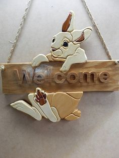 Bunny Rabbit Welcome Sign Wood Intarsia Handcrafted Wall Hanging I can personalize this with your name if you like. Intarsia is a pictorial of inlaid woods. This is how your Bunny Rabbit Sign was made. 1. Trace template on wood, paying attention to grain patterns and directions 2. Cut