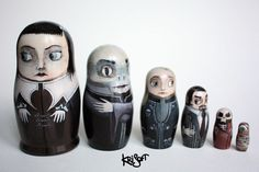 Vampires and more lurk in these nesting dolls by Krisoft.