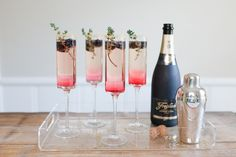 New Years Eve Blackberry Thyme Sparkler (Makes 4 Cocktails) 1 c. blackberries + 8 more for garnish 1 c. Water 1 c. sugar 1 bottle of champagne 4 ounces or c. gin 4 long sprigs of thyme 1 Cocktails Champagne, Cheap Champagne, New Year's Eve Cocktails, Champagne Flutes, Cocktail Drinks, Spring Cocktails, Cocktail Ideas, Champagne Taste, Cocktail Parties