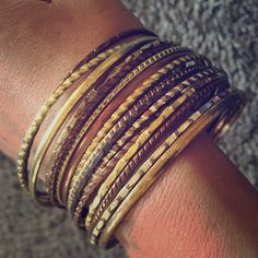 Multiple bangles. Shades of gold/bronze/copper. Multiple bangles. Shades of gold/bronze/copper. Jewelry Bracelets