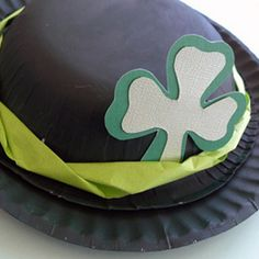 All dressed up for St. Pat's Day, using a paper plate and disposable bowl painted green.
