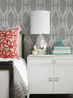 NOTE: Great Size modern chest as bedside table.  Gray bedroom with Phillip Jeffries Arches White on Gray Wallpaper. White modern chest with square nickel pulls. Mercury glass teardrop lamp on West Elm Lacquer Tray. White & black headboard with red floral pillow and gray quilt.  source: Laura Martin Bovard Interiors website