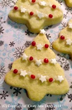 My shortbread Christmas trees are decorated with vanilla icing, shimmer star sprinkles and raspberry fudge pieces, instead of baubles and tinsel...xxx