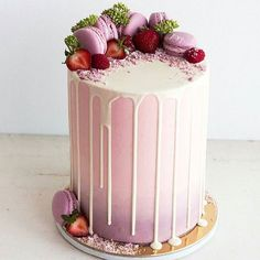 Pink layered cake with purple macarons and dripping white chocolate Fancy Cakes, Cute Cakes, Pretty Cakes, Beautiful Cakes, Amazing Cakes, Drippy Cakes, Bolo Cake, Occasion Cakes, Buttercream Cake