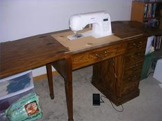 How to Convert an Old Sewing Cabinet or Table to Hold a New Sewing Machine | eHow Old Sewing Tables, Diy Sewing Table, Sewing Machine Tables, Sewing Desk, Vintage Sewing Table, Sewing Machine Cabinets, Sewing Machine For Sale, Sewing Machines Best, Vintage Sewing Machines