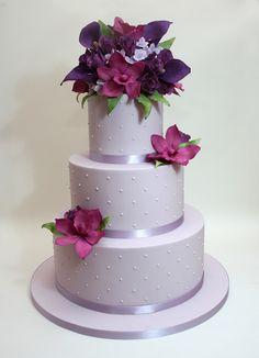 Purple wedding cake with polka dots