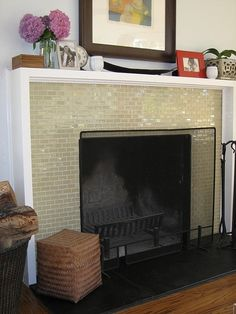 Love this look! The iridescent tiles give a lot of bang for the buck. This fireplace would shimmer beautifully in low or flickering light. Like the black stone at the bottom, too! The simple squared-off mantle does the job, letting the tilework be the star.
